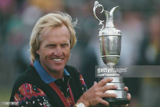 Greg Norman of Australia holds the Claret Jug after winning the 122nd Open Championship on 18th July 1993 at the Royal St George's Golf Club in...