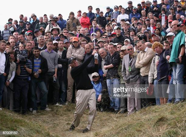 Greg Norman of Australia is watched by spectators as he hits a shot on the 8th during the final round of the 137th Open Championship on July 20 2008...