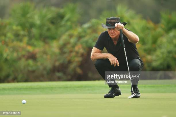 Greg Norman of Australia lines up a putt on the third green during the final round of the PNC Championship at the Ritz-Carlton Golf Club Orlando on...