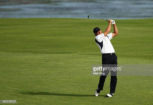 Greg Norman of Australia plays a fairway shot on the 17th hole during day two of the Australia Open at The Lakes Golf Club on December 3 2010 in...