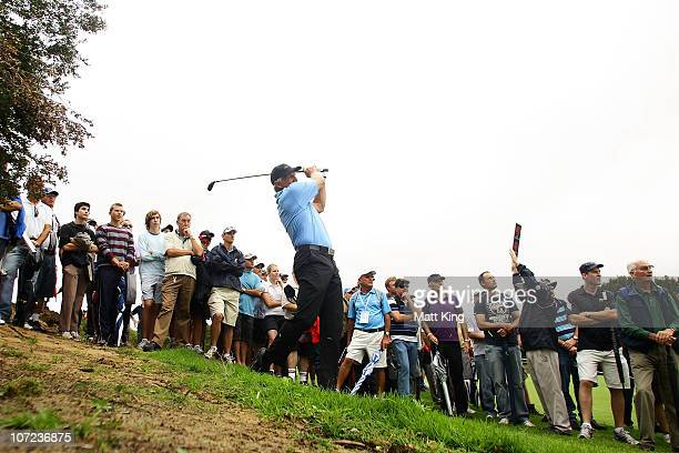 Greg Norman of Australia plays a shot out of the rough on the 14th hole during day one of the Australian Open at The Lakes Golf Club on December 2...