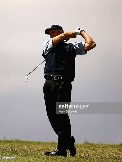 Greg Norman of Australia plays an iron into the second green during day one of the 2005 Heineken Classic at the Royal Melbourne Golf Club February 3...