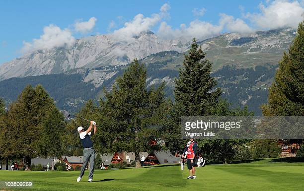 Greg Norman of Australia plays his second shot into the 15th green watched by his son and caddie Greg Norman during the second round of The Omega...