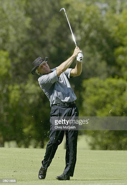 Greg Norman of Australia plays his second shot on the 13th hole during play on day 1 of the 2003 Australian PGA Championship held at the Hyatt...