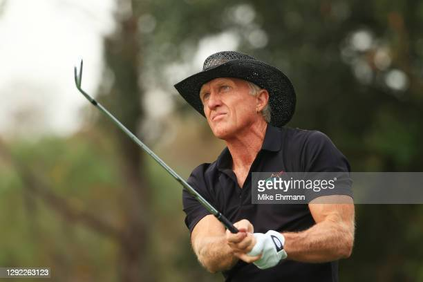 Greg Norman of Australia plays his shot from the fourth tee during the final round of the PNC Championship at the Ritz-Carlton Golf Club Orlando on...
