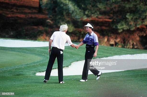 Greg Norman of Australia shakes hands with Larry Mize of the USA during the final round of The Masters in April 1987 at Augusta Georgia USA