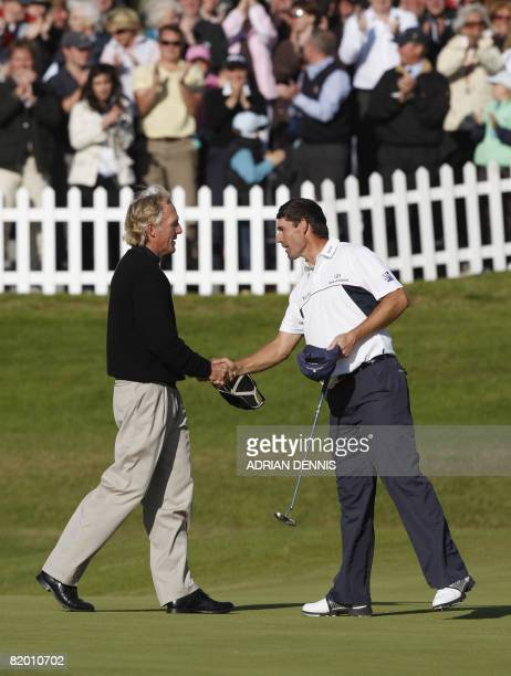 Greg Norman of Australia shakes hands with Padraig Harrington of Ireland after he won The Open golf tournament at Royal Birkdale in Southport in...
