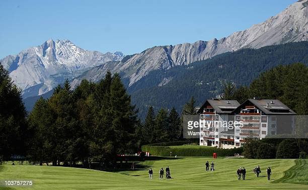 Greg Norman of Australia walks up the ninth fairway during the Pro Am prior to the start of The Omega European Masters at CransSurSierre Golf Club on...