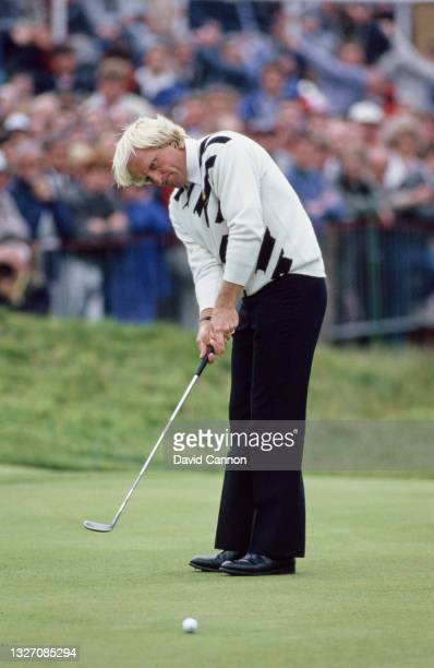 Greg Norman of Australia watches the golf ball to the hole following his putt on the green during the 115th Open Championship golf tournament on 18th...