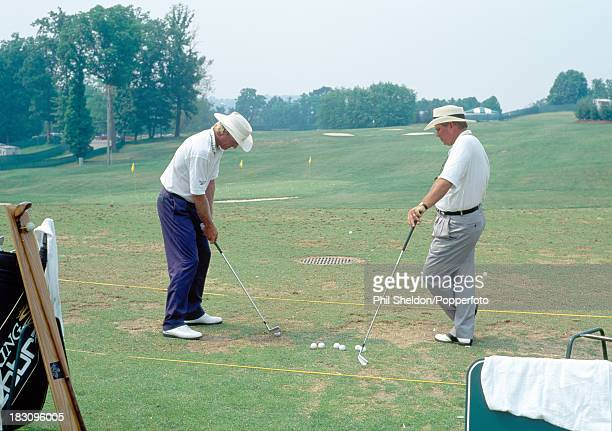 Greg Norman of Australia with his coach Butch Harmon prior to the US Open Golf Championship held at the Oakmont Country Club in Pennsylvania circa...
