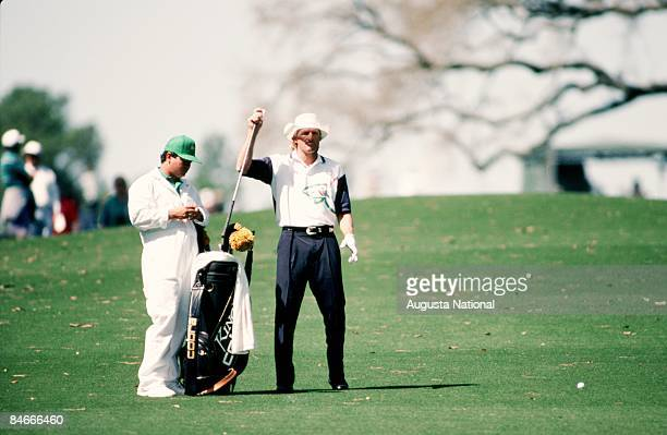 Greg Norman selects club from his bag with the help of his caddie during the 1993 Masters Tournament at Augusta National Golf Club on April 1993 in...