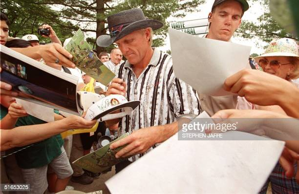 Greg Norman signs autographs 11 June during the last day of practice for the 1997 US Open Golf tournament at Congressional Country Club in Bethesda...