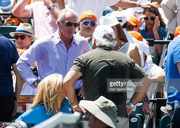 Greg Norman watches Novak Djokovic as he defeats Andy Murray 76 46 60 for the Men's Championship at the 2015 Miami Open in Key Biscayne Florida
