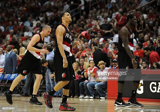 Greg Oden Brandon Roy and Steve Blake of the Portland Trail Blazers walk off the court during play against the Houston Rockets in Game Six of the...