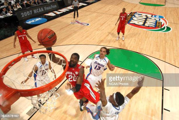 Greg Oden of OSU goes for a layup over Corey Brewer of Florida during the University of Florida vs Ohio State University championship game of the...