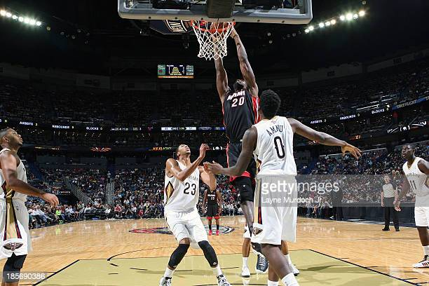 Greg Oden of the Miami Heat dunks the ball against the New Orleans Pelicans during an NBA preseason game on October 232013 at the New Orleans Arena...