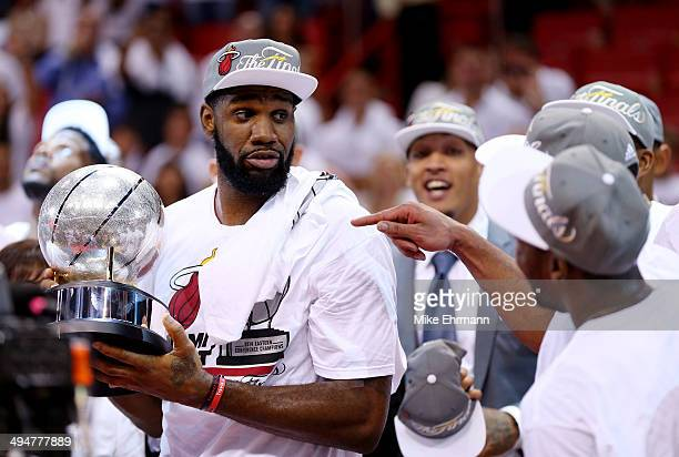 Greg Oden of the Miami Heat holds the trophy after defeating the Indiana Pacers in Game Six of the Eastern Conference Finals of the 2014 NBA Playoffs...