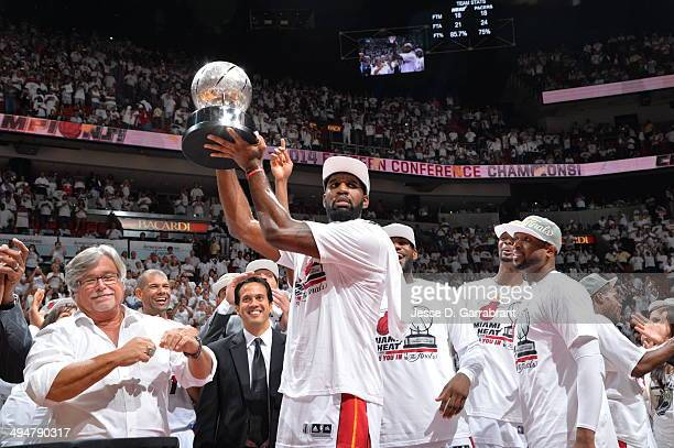 Greg Oden of the Miami Heat holds up the trophy after the win against the Indiana Pacers in Game Six of the Eastern Conference Finals during the 2014...