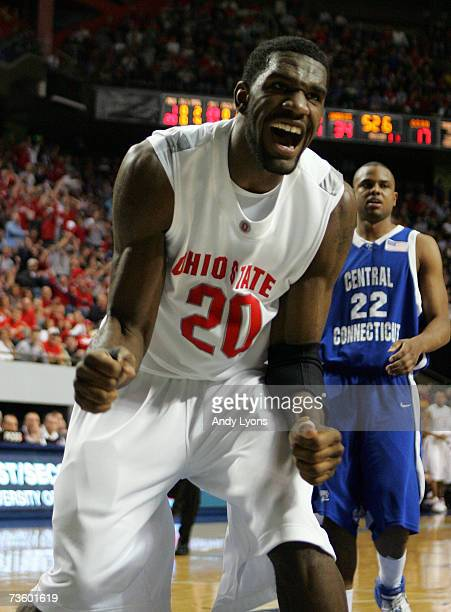 Greg Oden of the Ohio State Buckeyes celebrates as Jemino Sobers of the Central Connecticut State Blue Devils looks on during round one of the NCAA...
