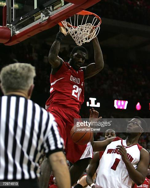 Greg Oden of the Ohio State Buckeyes dunks against Marcus Landry of the Wisconsin Badgers during their Big Ten Conference game on January 9 2007 at...