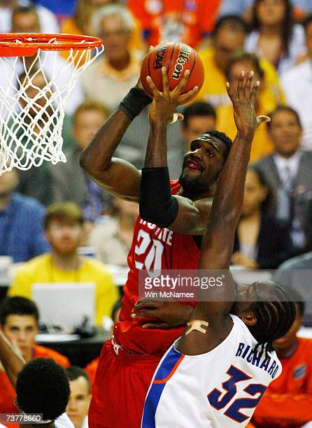 Greg Oden of the Ohio State Buckeyes goes to the hoop against Chris Richard of the Florida Gators in the NCAA Men's Basketball Championship game at...