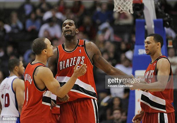 Greg Oden of the Portland Trail Blazers celebrates with teammates Brandon Roy and Jerryd Bayless during their game against the Los Angeles Clippers...