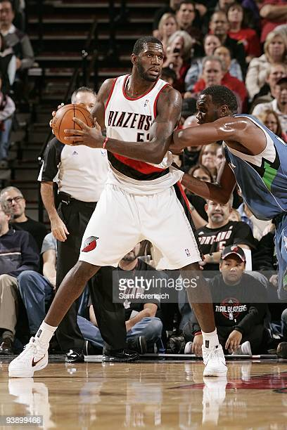 Greg Oden of the Portland Trail Blazers drives the ball against Al Jefferson of the Minnesota Timberwolves during the game on November 21 2009 at the...