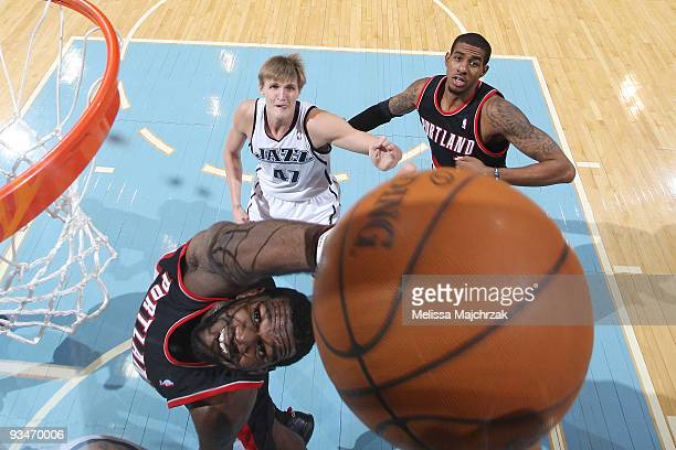 Greg Oden of the Portland Trail Blazers goes up for the rebound against the Utah Jazz at EnergySolutions Arena on November 28 2009 in Salt Lake City...