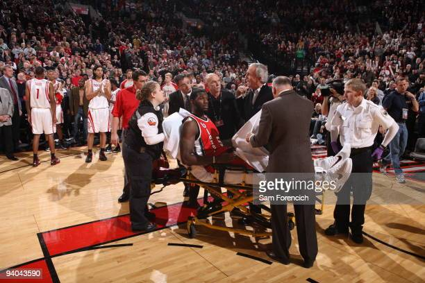 Greg Oden of the Portland Trail Blazers is helped my medical staff after a knee injury during a game against the Houston Rockets on December 5 2009...