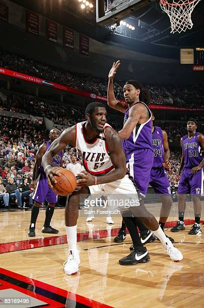 Greg Oden of the Portland Trail Blazers looks for the opening around Mikki Moore of the Sacramento Kings during a game on October 7, 2008 at the Rose...