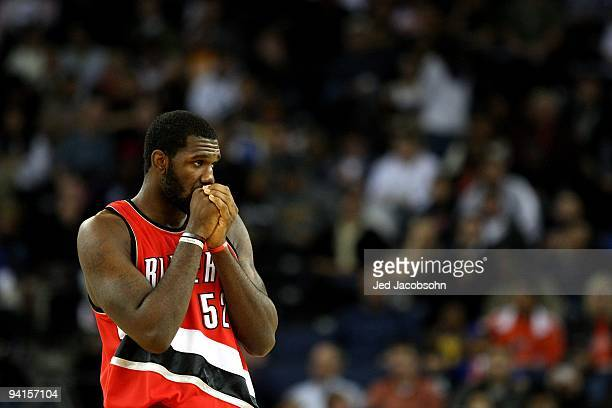 Greg Oden of the Portland Trail Blazers looks on against the Golden State Warriors during an NBA game at Oracle Arena on November 20 2009 in Oakland...