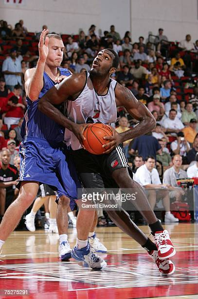 Greg Oden of the Portland Trail Blazers makes a move to the hoop against Nick Fazekas of the Dallas Mavericks during the NBA Summer League on July 8...