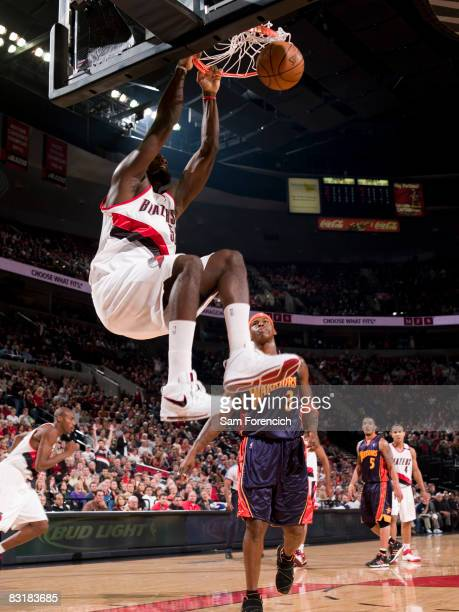 Greg Oden of the Portland Trail Blazers throws down a dunk infront of Al Harrington of the Golden State Warriors during a game on October 8 2008 at...