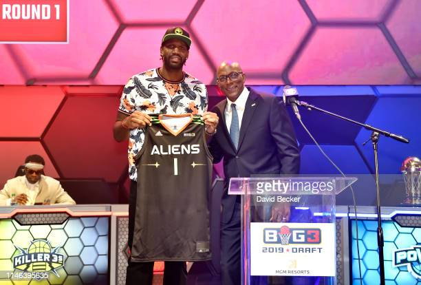 Greg Oden poses with BIG3 Commissioner Clyde Drexler after being drafted at by the Aliens in the first round during the BIG3 Draft at the Luxor Hotel...