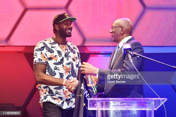Greg Oden shakes hands with BIG3 Commissioner Clyde Drexler after being drafted at by the Aliens in the first round during the BIG3 Draft at the...