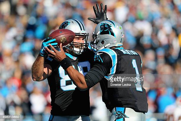 Greg Olsen and teammate Cam Newton of the Carolina Panthers celebrate a touchdown against the Washington Redskins in the 2nd quarter during their...