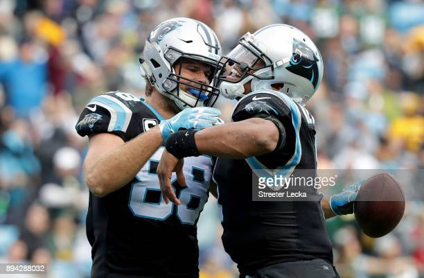 Greg Olsen celebrates with teammate Cam Newton of the Carolina Panthers after a touchdown against the Green Bay Packers in the third quarter during...