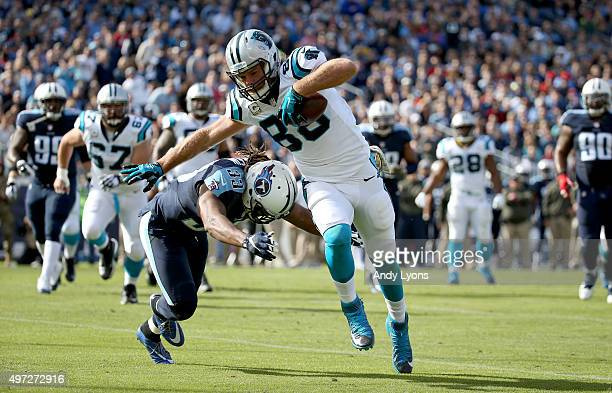 Greg Olsen of the Carolina Panthers attempts to escape a tackle attempt by Michael Griffin during the second quarter at LP Field on November 15 2015...