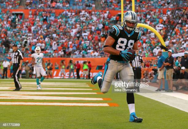 Greg Olsen of the Carolina Panthers catches a game winning touchdown during a game against the Miami Dolphins at Sun Life Stadium on November 24 2013...