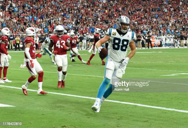 Greg Olsen of the Carolina Panthers catches a touch down pass from Kyle Allen against the Arizona Cardinals during the second half at State Farm...