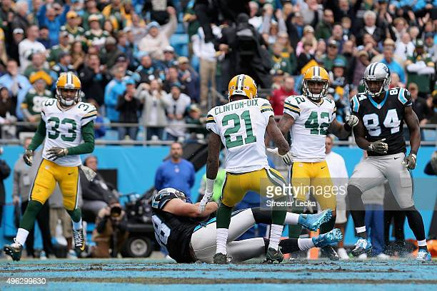 Greg Olsen of the Carolina Panthers catches a touchdown pass against Ha Ha ClintonDix of the Green Bay Packers in the 2nd quarter during their game...