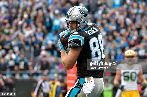 Greg Olsen of the Carolina Panthers catches a touchdown pass against the Green Bay Packers in the third quarter during their game at Bank of America...