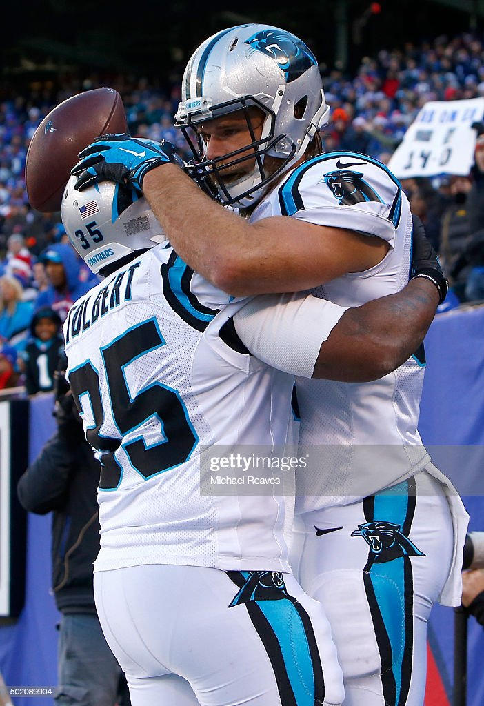 Greg Olsen #88 of the Carolina Panthers celebrates with Mike Tolbert #35 after scoring a 37 yard touchdown in the second quarter against the New York Giants during their game at MetLife Stadium on December 20, 2015 in East Rutherford, New Jersey.