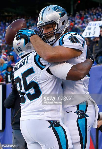 Greg Olsen of the Carolina Panthers celebrates with Mike Tolbert after scoring a 37 yard touchdown in the second quarter against the New York Giants...