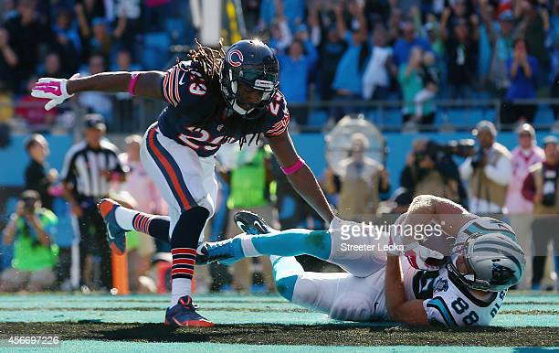 Greg Olsen of the Carolina Panthers comes down with a 4th quarter touchdown reception against the Chicago Bears at Bank of America Stadium on October...