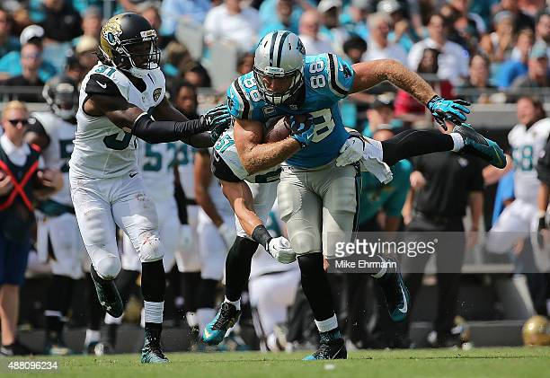 Greg Olsen of the Carolina Panthers evedes Davon House of the Jacksonville Jaguars during a game at EverBank Field on September 13 2015 in...