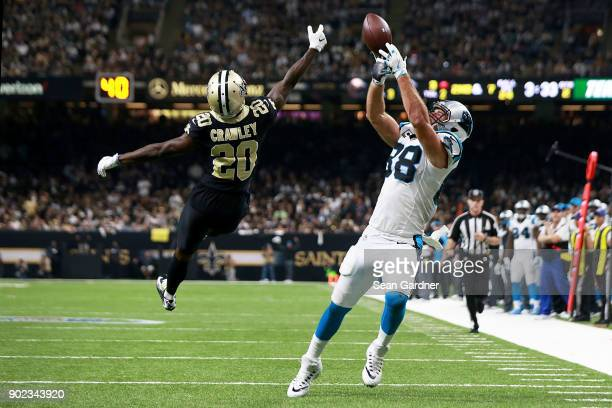 Greg Olsen of the Carolina Panthers has a pass broken up by Ken Crawley of the New Orleans Saints during the first half of the NFC Wild Card playoff...