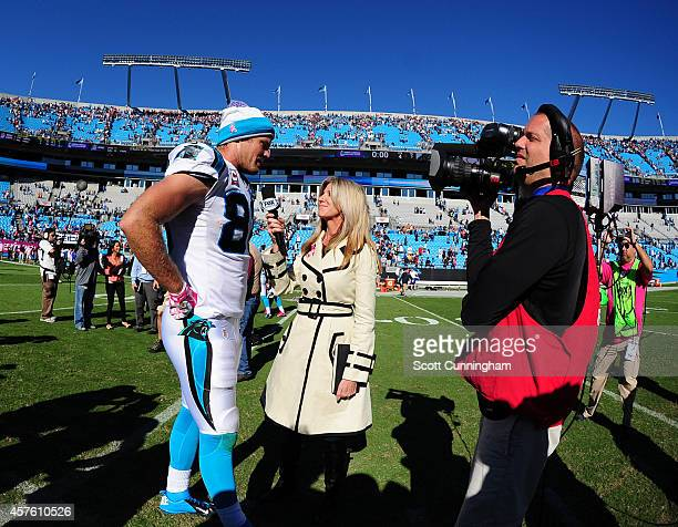 Greg Olsen of the Carolina Panthers is interviewed by Laura Okmin after the game against the Chicago Bears on October 5 2014 at Bank of America...