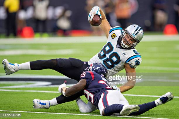 Greg Olsen of the Carolina Panthers is tackled by Tashaun Gipson Sr. #39 of the Houston Texans during a game at NRG Stadium on September 29, 2019 in...
