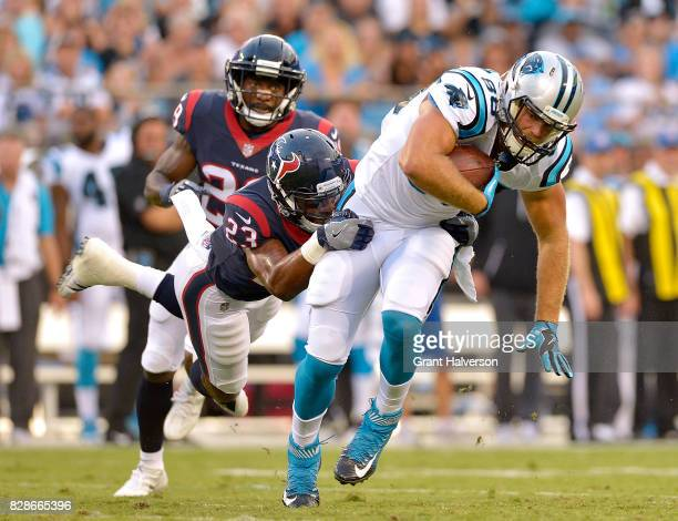 Greg Olsen of the Carolina Panthers makes a catch against Kurtis Drummond of the Houston Texans during their preseason game at Bank of America...